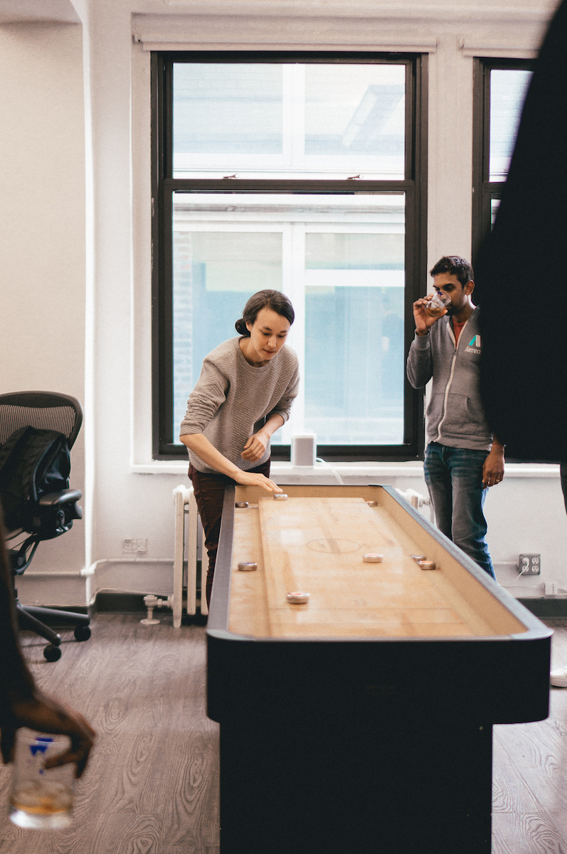 Starry team members playing shuffleboard